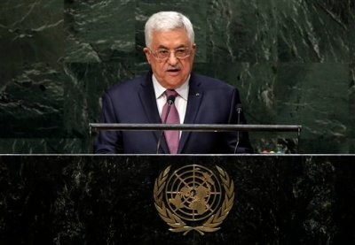In this Friday, Sept. 26, 2014, file photo, Palestinian President Mahmoud Abbas addresses the 69th session of the United Nations General Assembly at U.N. headquarters. The U.N. has accepted Palestine's request join the International Criminal Court, setting April 1 as the starting date and clearing the way for potential war crimes investigations of Israel over its settlement building on occupied lands and a 2014 war in Gaza that killed hundreds of civilians.  (AP Photo/Richard Drew, File)
