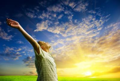 man-greets-the-sun-with-outstretched-arms