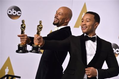 """Common, left, and John Legend pose in the press room with the award for best original song in a feature film for """"Glory"""" from """"Selma"""" at the Oscars on Sunday, Feb. 22, 2015, at the Dolby Theatre in Los Angeles. (Photo by Jordan Strauss/Invision/AP)"""