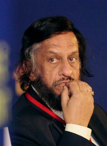 In this Feb. 6, 2010 file photo, Intergovernmental Panel on Climate Change Chairman Rajendra Pachauri listens to a speaker at the Delhi Sustainable Development Summit in New Delhi, India. The leader of the U.N.'s expert panel on climate change has stepped down amid an investigation into allegations of sexual harassment in his native India. (AP Photo/Gurinder Osan)