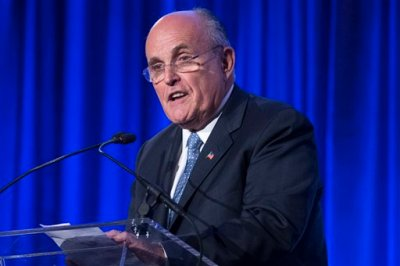"""In this May 12, 2014 file photo, former New York City Mayor Rudy Giuliani speaks in New York. Democrats on Thursday assailed Giuliani for questioning President Barack Obama's love of country, and urged the potential field of Republican presidential candidates to rebuke his comments. Democratic National Committee chair Debbie Wasserman Schultz said at the start of the DNC's winter meeting that now is the time for Republican leaders to """"stop this nonsense."""" (AP Photo/John Minchillo, File)"""