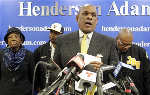 Attorney Victor P. Henderson, center, is joined from left by Anne Haley, president and co-founder of Jackie Robinson West Little League; Jackie Robinson West manager Darold Butler; and Bill Haley, director of Jackie Robinson West Little League, during a news conference, Thursday, Feb. 12, 2015, in Chicago. Henderson says he's working with local Little League officials to investigate the international governing body's decision to strip the Chicago team of its national title. (AP Photo/M. Spencer Green)
