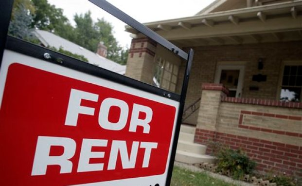 "In this Sept. 24, 2007 file photo, a ""for rent"" sign is posted outside a home in Denver.  Real estate data firm Zillow reports on U.S. home rental prices in January 2015 on Friday, Feb. 20, 2015. (AP Photo/David Zalubowski, File)"