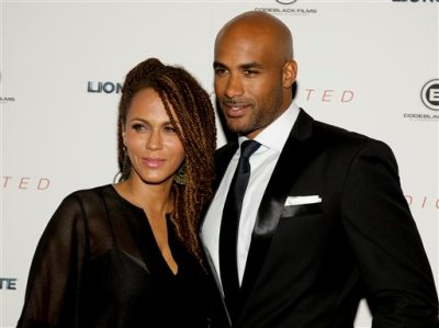 """In this Oct. 8, 2014 file photo, Nicole Ari Parker, left, and Boris Kodjoe, attend a screening of """"Addicted,"""" in New York. Kodjoe and Parker will be playing themselves on television in """"The Boris and Nicole Show"""" this summer. The married actors will host a talk show airing on Fox-owned stations in several markets, the station group said Thursday, Feb. 26, 2015. (Photo by Andy Kropa/Invision/AP, File)"""