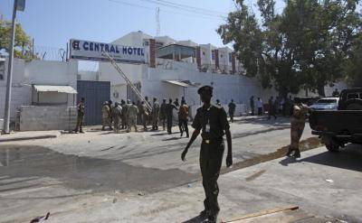 Somali security forces gather outside the scene of a twin bombing attack on a hotel in the capital Mogadishu, Somalia Friday, Feb. 20, 2015. One person rammed an explosives-laden vehicle into the gate of the Central Hotel in Somalia's capital, and another went through the gates and blew himself up, killing at least four people on Friday including the deputy mayor and a legislator, officials said, while the country's deputy prime minister was also among those wounded by the bombings. (AP Photo/Farah Abdi Warsameh)
