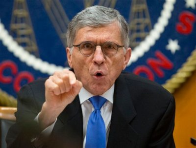 "Federal Communications Commission (FCC) Chairman Tom Wheeler gestures near the end of a hearing for a vote on Net Neutrality, Thursday, Feb. 26, 2015, at the FCC in Washington. The FCC has agreed to impose strict new regulations on Internet service providers like Comcast, Verizon and AT&T. The regulatory agency voted 3-2 Thursday in favor of rules aimed at enforcing what's called ""net neutrality."" That's the idea that service providers shouldn't intentionally block or slow web traffic, creating paid fast lanes on the Internet. (AP Photo/Pablo Martinez Monsivais)"