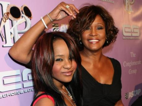 """Bobbi Kristina and Whitney Houston attend """"Kelly Price & Friends Unplugged: For The Love of R&B"""" on Feb. 9, 2012, at Tru Hollywood in Hollywood, California. (AP Photo)"""
