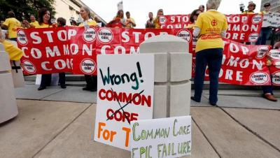 People protesting the Common Core education standards demonstrate near the hotel where the meeting of Tennessee's Education Summit is taking place on Thursday, Sept. 18, 2014, in Nashville, Tenn. (AP Photo)