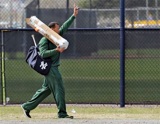 New York Yankees third baseman Alex Rodriguez waves as he arrives at the Yankees' minor league complex Monday, Feb. 23, 2015, in Tampa, Fla. (AP Photo/Chris O'Meara)
