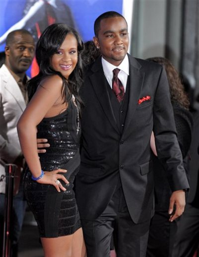 """In this Aug. 16, 2012, file photo, Bobbi Kristina Brown, left, and Nick Gordon attend the Los Angeles premiere of """"Sparkle"""" at Grauman's Chinese Theatre in Los Angeles. Messages of support were being offered Monday, Feb. 2, 2015, as people awaited word on Brown, who authorities say was found face down and unresponsive in a bathtub over the weekend in a suburban Atlanta home. (Photo by Jordan Strauss/Invision/AP, File)"""
