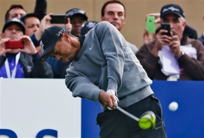 Tiger Woods tees off on the first hole during the pro-am at the Farmer Insurance Open golf tournament at Torrey Pines, Wednesday, Feb. 4, 2015, in San Diego. (AP Photo/Lenny Ignelzi)