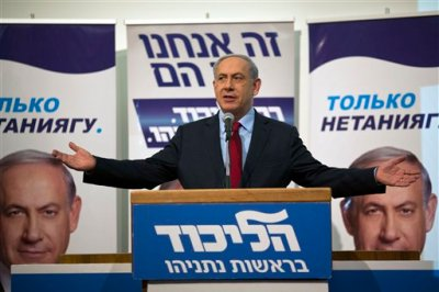 Israeli Prime Minister Benjamin Netanyahu speaks to his Likud party members during a campaign event near Tel Aviv, Israel, Monday, Feb. 9, 2015. Netanyahu on Monday accused the publisher of the Yediot Ahronot daily newspaper of carrying out a smear campaign against him in the hopes of pushing him out of office. (AP Photo/Ariel Schalit)