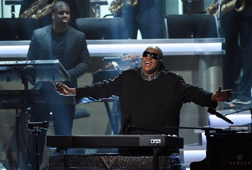 """FILE-- In this Tuesday, Feb. 10, 2015 file photo, Stevie Wonder takes in applause from the stage during the finale of """"Stevie Wonder: Songs in the Key of Life - An All-Star Grammy Salute,"""" at the Nokia Theatre L.A. Live in Los Angeles.  The show will air 9-11 p.m. EST Monday, Feb. 16, 2015, on CBS. (Photo by Chris Pizzello/Invision/AP, File)"""