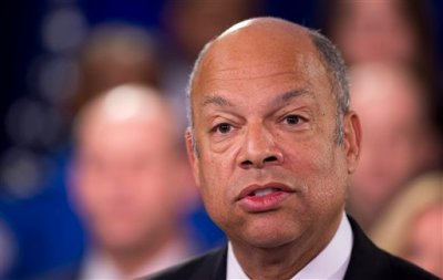 Homeland Security Secretary Jeh Johnson, joined by the department employees, during a news conference in Washington, Monday, Feb. 23, 2015. A partial shutdown of the Homeland Security Department loomed at week's end, but no solution was in sight as senators returned to the Capitol from a week-long recess Monday to confront an impasse over the issue. (AP Photo/Manuel Balce Ceneta)