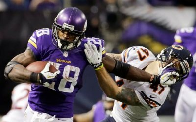 In this Dec. 1, 2013, fikle photo, Minnesota Vikings running back Adrian Peterson, left, tries to break a tackle from Chicago Bears free safety Chris Conte during the fourth quarter of an NFL football game in Minneapolis. A federal judge has cleared the way for Peterson to be reinstated. U.S. District Judge David Doty issued his order Thursday, Feb. 26, 2015, less than three weeks after hearing oral arguments. (AP Photo/Ann Heisenfelt, File)