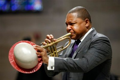 In this Sept. 20, 2014, file photo, musician Wynton Marsalis performs during a memorial service for actress Ruby Dee at The Riverside Church in New York. It was announced Wednesday, March 11, 2015, that Marsalis is scratching a concert in Venezuela amid rising tensions between Venezuela and the U.S. that are making it harder for U.S. citizens to travel to the South American country. (AP Photo/Jason DeCrow, File)