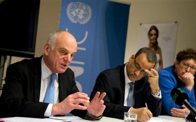 Dr. David Nabbaro, left, a medical doctor organizing the United Nations' response to the Ebola crisis, speaks during a media conference at the UN office in Brussels on Monday, March 2, 2015. African heads of state and NGO's will meet Tuesday to discuss the Ebola crisis. (AP Photo/Virginia Mayo)