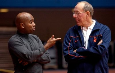 """In this Oct. 27, 2005, file photo, Syracuse University athletic director Daryl Gross, left, talks with basketball coach Jim Boeheim during practice in Syracuse, N.Y. Syracuse university officials say coach Boeheim will retire in three years and athletic director Daryl Gross has resigned following punishment from the NCAA for violations that lasted more than a decade. Chancellor Kent Syverud said Wednesday, March 18, 2015, that Boeheim, a Hall of Famer and head coach for 39 years, decided to make the announcement to """"bring certainty to the team and program in the coming years"""" and to allow for a smooth transition. (AP Photo/Kevin Rivoli)"""