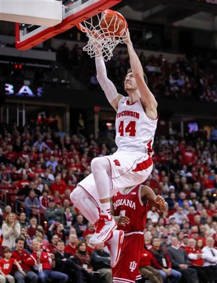 FILE - In this Feb. 3, 2015, file photo, Wisconsin forward Frank Kaminsky dunks against Indiana during the second half of an NCAA college basketball game in Madison, Wis. Kaminsky was selected to the AP All-America team, Monday, March 30, 2015. (AP Photo/Andy Manis, File)