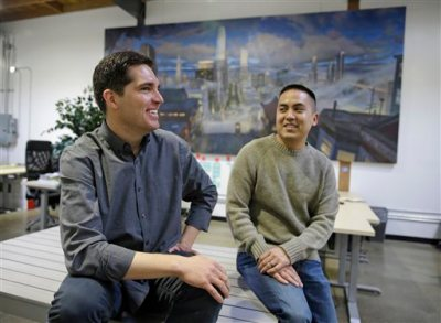 In this photo taken Monday, March 23, 2015, Vessel CEO and co-founder Jason Kilar, left, and co-founder Richard Tom pose for a photo at their headquarters in San Francisco. If you can't wait to watch some of the Internet's best video clips, it's going to cost you. That's the idea behind Vessel, a new service seeking to transform the way that short video pieces make money on the Internet. Instead of focusing on a free-for-all concept supported solely by advertising, Vessel will charge $3 per month to see music, sports, comedy and other clips that won't be available on YouTube or any other digital video service for at least 72 hours. The concept makes its debut Tuesday after two months of testing with an undisclosed number of people who received invitations to participate. (AP Photo/Eric Risberg)