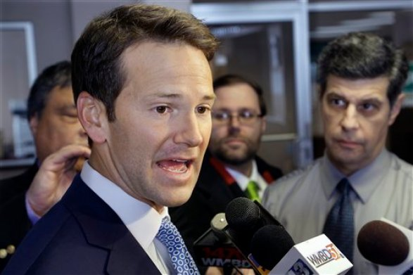FILE - In this Feb. 6, 2015, file photo, Rep. Aaron Schock, R-Ill. speaks to reporters in Peoria Ill. According to a source, the Justice Department is investigating possible criminal violations by resigning Illinois congressman. (AP Photo/Seth Perlman, File)