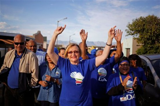 "FILE-In this file photo taken on Tuesday, May 6, 2014, South African opposition leader Hellen Zille, centre, from the Democratic Alliance, participates un a party rally in Rocklands on the outskirts of Cape Town, South Africa. An article about fetal alcohol syndrome published earlier March in South Africa's Cape Times has set off a divisive debate about 'Baby Thomas' who is alleged to have been damaged by alcohol, but Hellen Zille has questioned whether the article is accurate, saying there is ""no clear time frame and scant details"" about a baby that allegedly was damaged in the womb by his mother's drinking. (AP Photo/Schalk van Zuydam, FILE)"