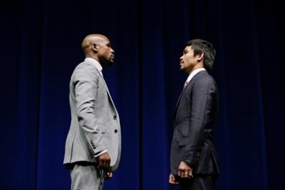 Boxers Floyd Mayweather Jr., left, and Manny Pacquiao, of the Philippines, pose for photos during a news conference, Wednesday, March 11, 2015, in Los Angeles. The two are scheduled to fight in Las Vegas on May 2. (AP Photo/Jae C. Hong)