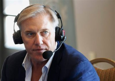 Denver Broncos general manager John Elway pauses during an interview for a radio show at the NFL football Annual Meeting, Monday, March 23, 2015, in Phoenix. (AP Photo/Ross D. Franklin)
