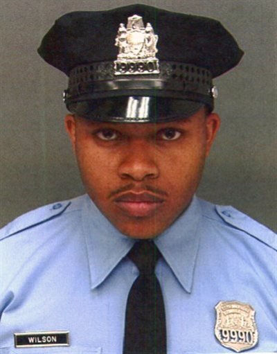 This undated photo provided by Philadelphia Police Department, shows Robert Wilson III. Wilson, a Philadelphia police officer, was shot in the head and killed after he and his partner exchanged gunfire with two suspects trying to rob a video game store, city officials said Thursday, March 5, 2015. (AP Photo/Philadelphia Police Department)