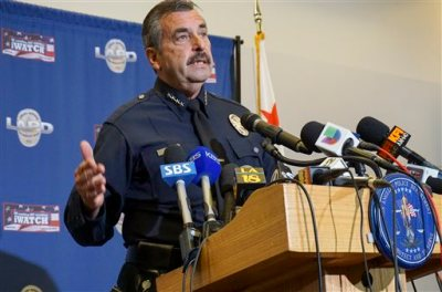 "Los Angeles Police Chief Charlie Beck comments on the shooting of a homeless man on Skid Row of  Los Angeles, at a news conference at police headquarters, Monday, March 2, 2015. Police fatally shot a homeless man on Skid Row during a ""brutal"" videotaped struggle in which a rookie officer cried out that the man had hold of his gun before three other officers opened fire, the Los Angeles police chief said Monday. (AP Photo/Damian Dovarganes)"