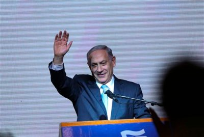 In this March 18, 2015, file photo, Israeli Prime Minister Benjamin Netanyahu greets supporters at the party's election headquarters in Tel Aviv. Netanyahu apologized to Israel's Arab citizens on Monday, March 23, 2015, for remarks he made during last week's parliament election that offended members of the community. (AP Photo/Oded Balilty, File)
