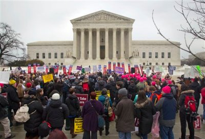 In this March 4, 2015, file photo, a crowd gathers outside the Supreme Court in Washington, as the court hears arguments in King v. Burwell. A new poll finds that most Americans are totally unaware that the Supreme Court case that could unravel President Barack Obama's health care law.  (AP Photo/Pablo Martinez Monsivais, File)