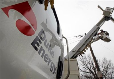 In this Feb. 14, 2012 file photo, Duke Energy employees work on power lines in Charlotte, N.C. Duke Energy Corp. reports quarterly earnings on Tuesday, Feb. 18, 2014. (AP Photo/Chuck Burton, File)