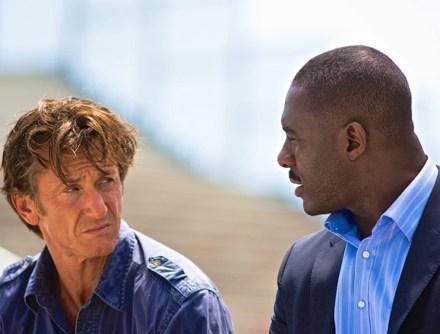 "Sean Penn and Idris Elba in the international thriller ""The Gunman."" (Courtesy Photo)"