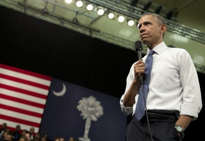 President Obama pauses as he listens to a question during a town-hall meeting at Benedict College on Friday in Columbia, S.C., about the importance of community involvement. (Carolyn Kaster/AP)