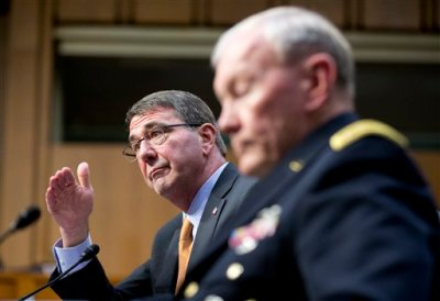 "In this March 3, 2015 file photo, Defense Secretary Ash Carter, left, accompanied by Joint Chiefs Chairman Gen. Martin Dempsey, testifies on Capitol Hill in Washington before the Senate Armed Services Committee. Iran's growing influence in Iraq is setting off alarm bells, and nowhere is the problem starker than in the high-stakes battle for Tikrit. It marks a crucial fight in the bigger war to expel the Islamic State group from Iraq, and yet Iran and the Shiite militias it empowers _ not the U.S. _ are leading the charge. Carter, under questioning from Sen. John McCain this week, acknowledged his concern when McCain asked if it alarms him that Iran ""has basically taken over the fight."" (AP Photo/Manuel Balce Ceneta, File)"