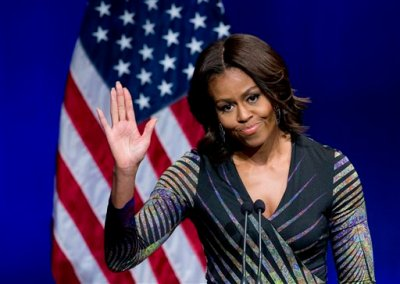 """First lady Michelle Obama waves while speaking at the Newseum in Washington, Wednesday, March 4, 2015, to launch the """"Change Direction"""" campaign. Michelle Obama says mental health care is not just a policy and budget issue for America, but also a cultural issue. The first lady says there should be  no stigma around mental health, and the real change requires a shift in """"our attitudes."""" Mrs. Obama spoke Wednesday at a mental health summit and the national launch of the campaign to """"Change Direction."""" (AP Photo/Manuel Balce Ceneta)"""