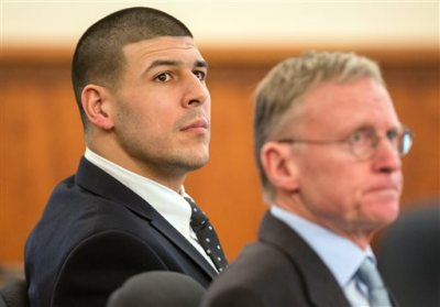 Former New England Patriots NFL football player Aaron Hernandez, left, sits beside his lawyer Charles Rankin during his murder trial at Bristol County Superior Court, Tuesday, March 24, 2015, in Fall River, Mass. Hernandez is charged with killing semiprofessional football player Odin Lloyd in June 2013. (AP Photo/The Boston Globe, Aram Boghosian, Pool)
