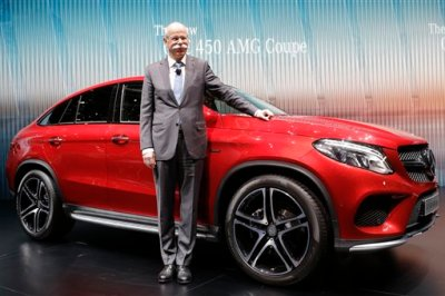 Daimler CEO Dieter Zetsche presents the new Mercedes GLE 450 AMG Coupe on the first press day of the Geneva International Motor Show Tuesday, March 3, 2015 in Geneva, Switzerland. The show opens its doors to the public March 5 through March 15. (AP Photo/Laurent Cipriani)