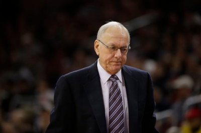 In this Dec. 20, 2014, file photo, Syracuse head coach Jim Boeheim reacts during an NCAA college basketball game against Villanova in Philadelphia. The NCAA has suspended Syracuse coach Jim Boeheim Friday, March 6, 2015, for nine games for academic, drug and gifts violations committed primarily by the men's basketball program.(AP Photo/Matt Slocum, File)
