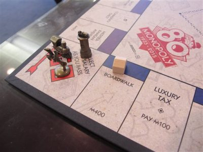 This March 11, 2015 photo shows a Monopoly board in Atlantic City, N.J. - the city on whose real-life streets the Monopoly board game is based. The board game turns 80 years old on Thursday, March 19, 2015. (AP Photo/Wayne Parry)