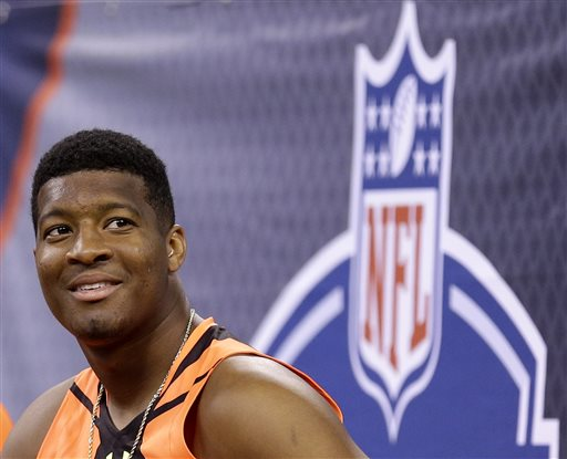 This is a Feb. 21, 2015, file photo showing Jameis Winston at the NFL football scouting combine in Indianapolis. Winston has spent much of the past two months crisscrossing the nation, sharpening his quarterback skills and trying to convince NFL teams he's learned from mistakes made off the field and ready to become the face of a franchise. (AP Photo/David J. Phillip, File)