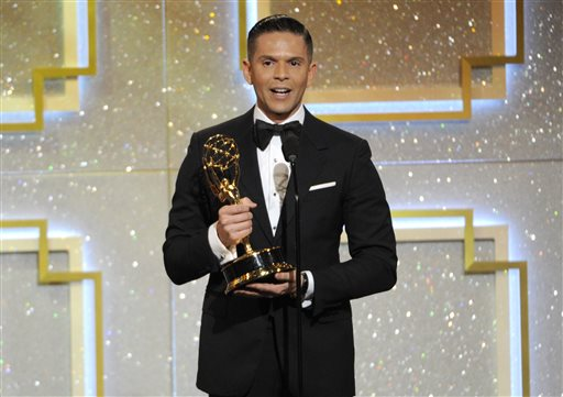 "In this June 22, 2014 file photo, Rodner Figueroa accepts the award for outstanding daytime talent in Spanish for ""El Gordo y la Flaca"" at the 41st annual Daytime Emmy Awards in Beverly Hills, Calif. Figueroa was fired from Univision after saying that Michelle Obama looks like someone from the cast of ""Planet of the Apes."" Figueroa, who's known for his biting fashion commentary, made his remarks during a live segment of the show ""El Gordo y la Flaca"" in which the hosts were commenting on a viral video that shows  a makeup artist transforming  himself into different celebrities, including Michelle Obama. (Photo by Chris Pizzello/Invision/AP, File)"