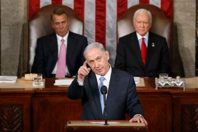 In this March 3, 2015, file photo, Israeli Prime Minister Benjamin Netanyahu gestures as  he speaks before a joint meeting of Congress on Capitol Hill in Washington. House Speaker John Boehner of Ohio, left, and Sen. Orrin Hatch, R-Utah, listen. Relations between President Barack Obama and congressional Republicans have hit a new low. There has been little direct communication between Obama and the GOP leadership on Capitol Hill since Republicans took full control of Congress in January. Obama has threatened to veto more than a dozen Republican-backed bills. And Boehner infuriated the White House by inviting Netanyahu to address Congress without consulting the administration first.  (AP Photo/Andrew Harnik, File)
