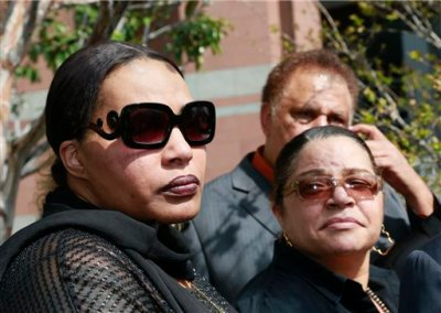 """In this Tuesday, March 10, 2015 file photo, Marvin Gaye's daughter, Nona Gaye, left, and his ex-wife, Janis Gaye, take questions from the media outside Los Angeles U.S. District Court, after a jury awarded the singer's children nearly $7.4 million after determining singers Robin Thicke and Pharrell Williams copied their father's music to create """"Blurred Lines."""" Marvin Gaye's family is seeking to stop the distribution of """"Blurred Lines."""" Gaye's children filed a motion in court Tuesday, March 17, 2015, to prevent the copying, distributing and performing of the hit song featuring Pharrell, Robin Thicke and T.I.  (AP Photo/Nick Ut, File)"""