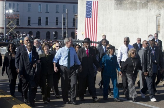 "Laura Bush, second from left, and former President George W. Bush, as well as members of Congress and civil rights leaders make a symbolic walk across the Edmund Pettus Bridge in Selma, Ala., for the 50th anniversary of ""Bloody Sunday,"" a landmark event of the civil rights movement, Saturday, March 7, 2015. (AP Photo/Jacquelyn Martin)"