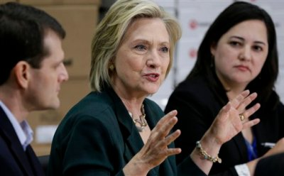 Democratic presidential candidate Hillary Rodham Clinton, center, speaks during a small business roundtable, Wednesday, April 15, 2015, in Norwalk, Iowa. (AP Photo/Charlie Neibergall)