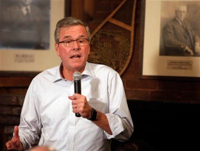 """Former Florida Gov. Jeb Bush speaks to a group at a Politics and Pie at the Snow Shoe Club Thursday, April 16, 2015, in Concord, N.H. Bush said Thursday he will make up his mind """"in relatively short order"""" whether to seek the Republican nomination for president in 2016.  Nearly 20 Republican White House prospects will court primary voters in New Hampshire this weekend at a GOP meeting in Nashua. It's the first gathering of its kind in New Hampshire as contenders deliver speeches, answer questions and hope to make a mark. (AP Photo/Jim Cole)"""