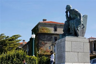 In this photo taken on Tuesday, March 17, 2015, a statue of British colonialist Cecil John Rhodes at the University of Cape Town near the city centre of Cape Town, South Africa.  On March 9, 2015, a South African student protester tossed feces onto the statue of Rhodes, igniting nationwide calls to remove other statues of former white leaders, and the uproar continues as part of a larger discourse about change in South Africa, and the legacy of apartheid. (AP Photo/Schalk van Zuydam)