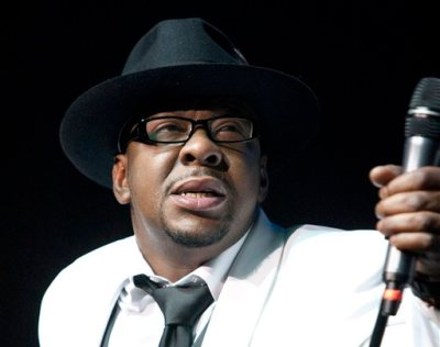 """In this Feb. 18, 2012 file photo, singer Bobby Brown, former husband of the late Whitney Houston performs with New Edition at Mohegan Sun Casino in Uncasville, Conn. Brown told concert goers Saturday, April 18, 2015, that his daughter Bobbi Kristina Brown is awake nearly three months after she was found face down and unresponsive in a tub at her Georgia home. In a video, Brown tells the crowd during a concert appearance at the Verizon Theatre in Dallas, Texas, that """"Bobbi is awake,"""" adding that """"she is watching me."""" The crowd screamed after his remark. (AP Photo/Joe Giblin, file)"""
